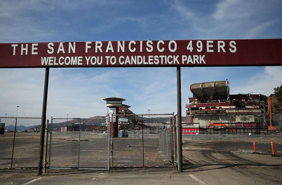 A sign remains at the entrance to the parking lot at Candlestick Park as demolition continues on June 9, 2015 in San Francisco, California. The demolition of Candlestick Park, the former home of the San Francisco Giants and San Francisco 49ers, is in its final stages with approximately 75 percent of of the structure reduced to rubble. A development with a mall and housing is planned for the site.  Photo: Justin Sullivan, Getty Images