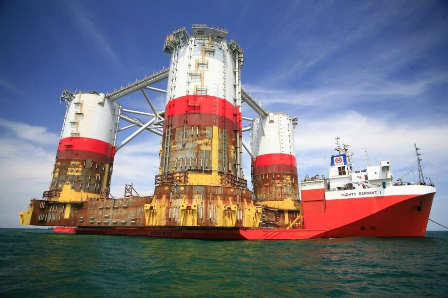 The hull of Chevron's Big Foot oil platform arrived in Texas in March 2013, after a three-month journey from Korea. It is scheduled to begin production in early 2014, 225 miles south of New Orleans, floating in 5,200 feet of water. Photo: Chevron
