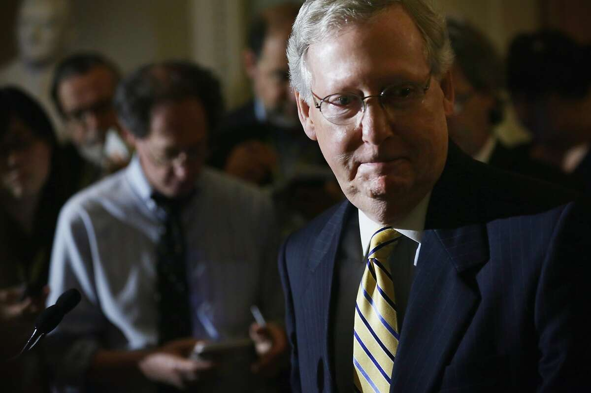 """WASHINGTON, DC - MAY 19: U.S. Sen. Senate Majority Leader Sen. Mitch McConnell (R-KY) turns away after a news conference at the Capitol May 19, 2015 in Washington, DC. The legislators held a news conference with small business owners from Ohio, Wisconsin and Kentucky to discuss trade and """"the importance of exports to American small businesses and the need for Trade Promotion Authority."""" (Photo by Alex Wong/Getty Images)"""