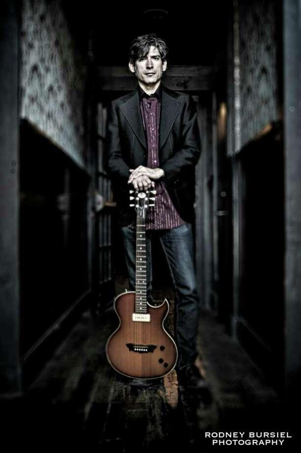 Colin Gilmore says traveling provides inspiration for his music. Photo: Rodney Bursiel