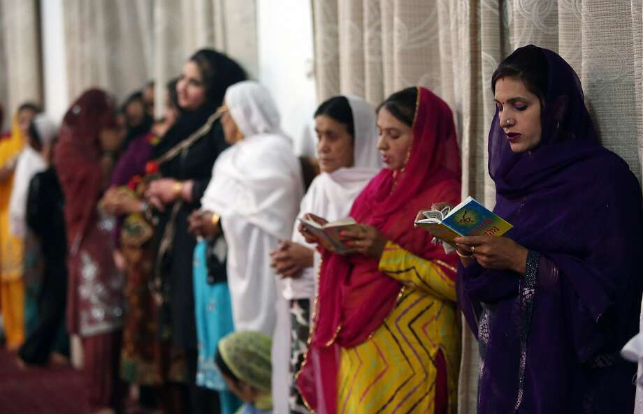 Afghan Sikhs read the central religious text of Sikhism, during a service in the capital, Kabul. Afghanistan's Sikh population has fallen to an estimated 2,500. Photo: Rahmat Gul, Associated Press