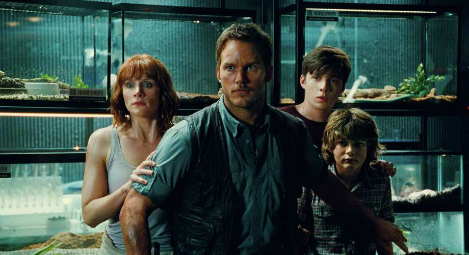 """Bryce Dallas Howard, from left, Chris Pratt, Nick Robinson and Ty Simpkins star in """"Jurassic World."""" Photo: Universal Pictures/Amblin Entert, HONS / Universal Pictures"""