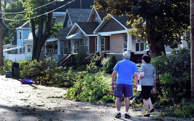 Residents of Sixth Street survey the damage Wednesday morning June 10, 2015 after a EF 0 tornado blew through the area yesterday in Scotia, N.Y.   (Skip Dickstein/Times Union) Photo: SKIP DICKSTEIN