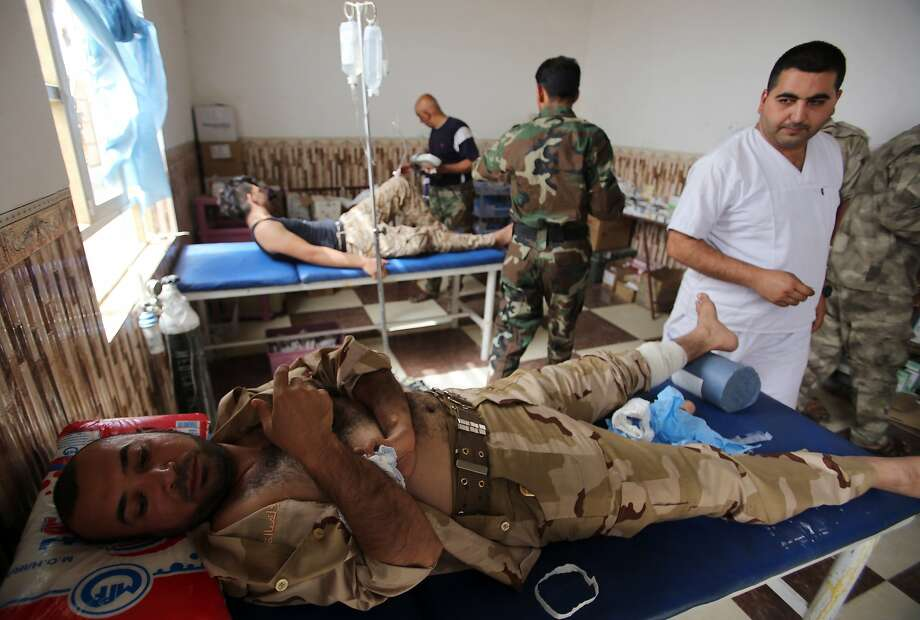 Iraqi doctors treat wounded soldiers at a field hospital in the town of Baiji, as allied Iraqi forces fight against the Islamic State to try to retake the strategic northern town for a second time. Photo: Ahmad Al-Rubaye, AFP / Getty Images