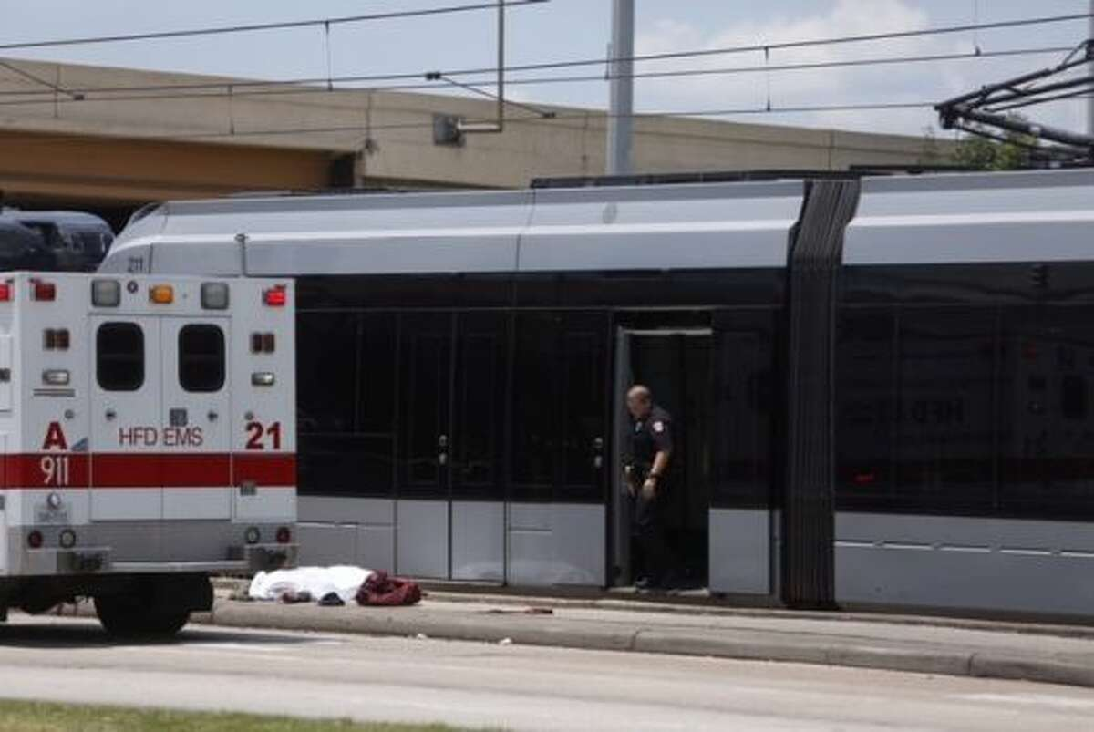 Officials investigate after a pedestrian was killed in an collision with a Metro rail train on June 10 near Loop 610.