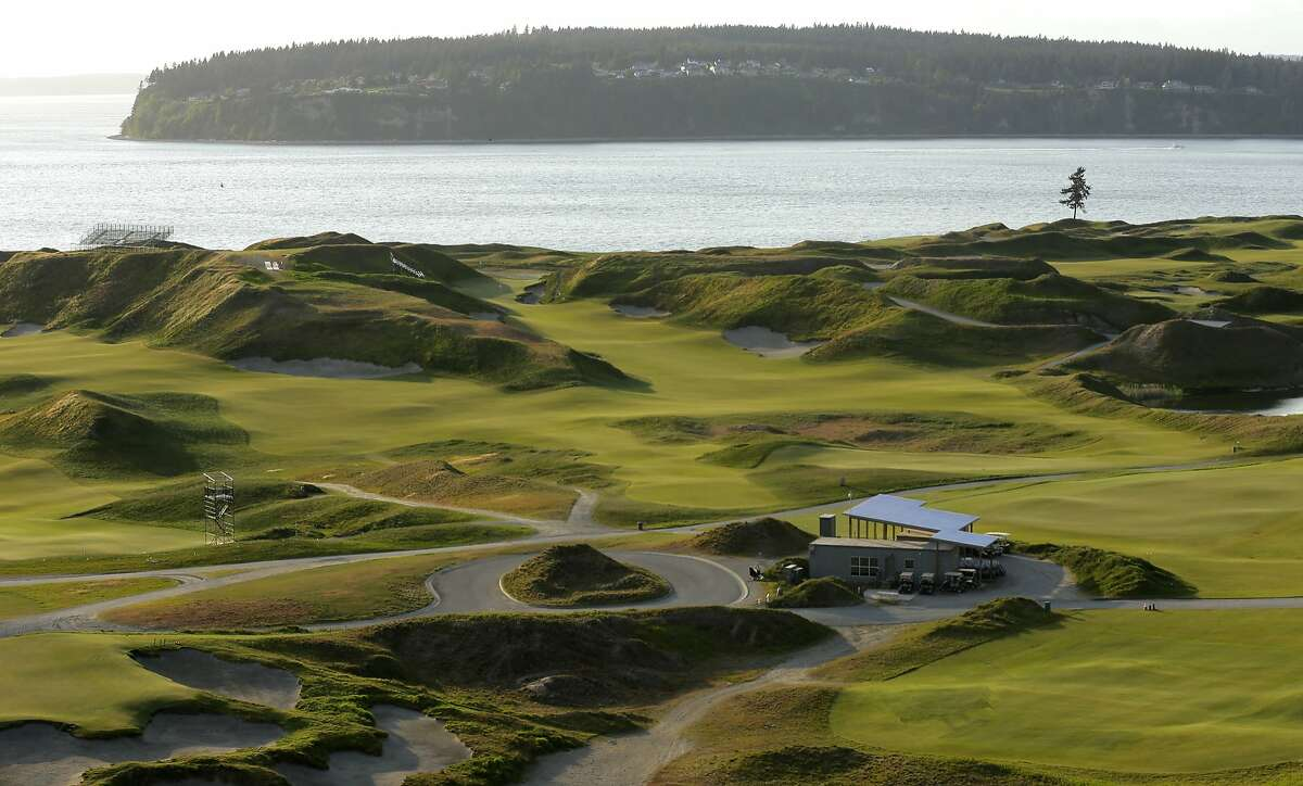 In this photo taken April 27, 2015, Chambers Bay golf course in University Place, Wash. is shown with Fox Island in the background. The course will host the 2015 U.S. Open Championship in June, the first U.S. Open to come to the Pacific Northwest. (AP Photo/Ted S. Warren)