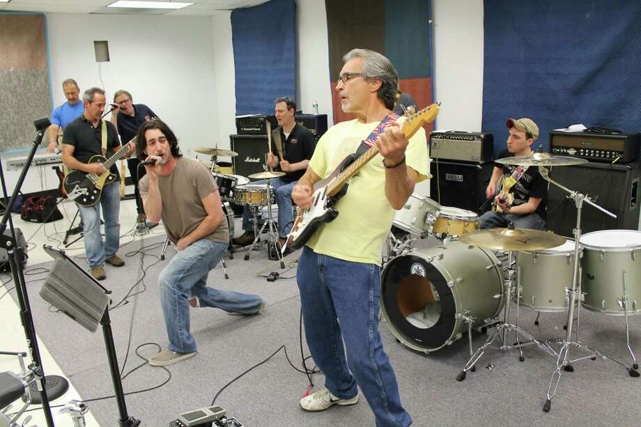 Musicians rehearse June 3 for the Stamford Summer Musical Festival, to be held June 13 from noon to 10 p.m. in Mill River Park as a benefit for the Joseph Roberts Sr. Music Foundation. From left, keyboardist Mike Giordano; guitarist Tom Nastasi; vocalist Allan Tepper; lead vocalist Larry Nardi Jr.; drummer Mario Socci; guitarist Larry Nardi Sr. and (seated) Tony Socci Jr. Photo: John Breunig / John Breunig / Stamford Advocate