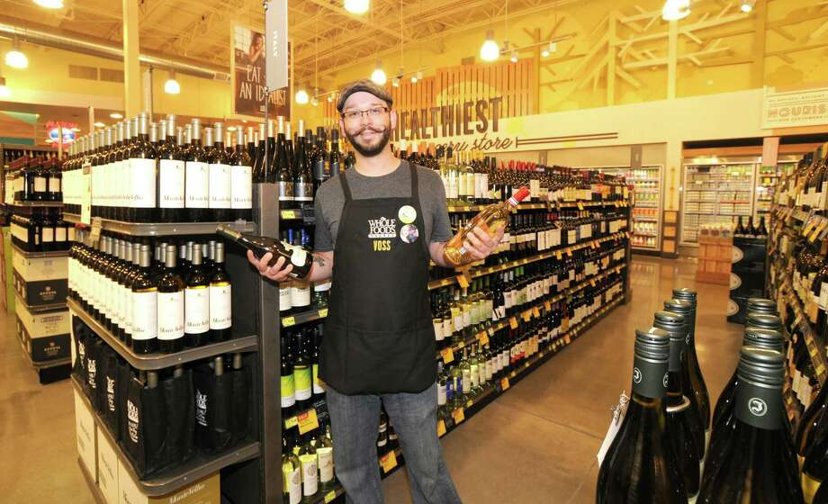Beer specialist Ryan Lewis is a team leader at the Whole Foods Market on South Voss Road.Beer specialist Ryan Lewis is a team leader at the Whole Foods Market on South Voss Road. Photo: George Wong / Freelance