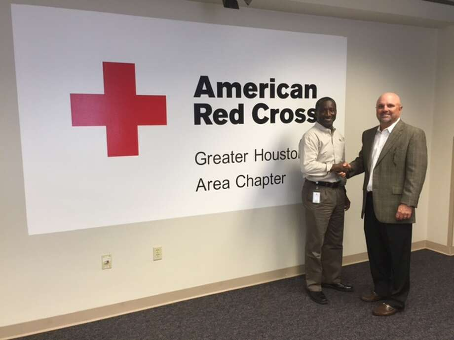 Derrick Chubbs, division vice president Southwest and Rocky Mountain's Red Cross Division, with Wyatt Wainwright, HADA president (right).