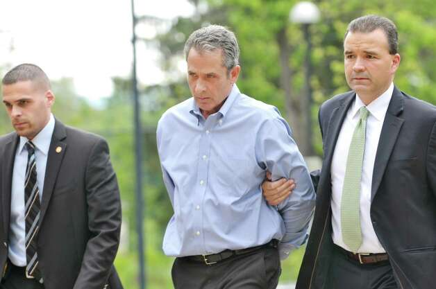 Fred Monroe of Capital Financial Planning is brought into Guilderland Town Court on Wednesday, June 10, 2015, in Guilderland, N.Y.   (Paul Buckowski / Times Union) Photo: PAUL BUCKOWSKI / 10032246A