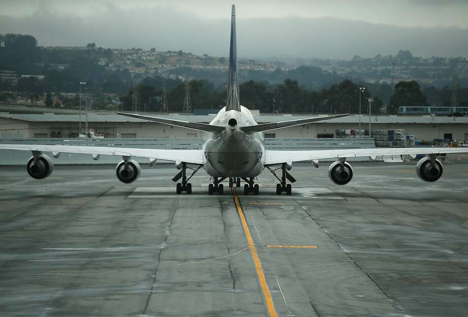SAN FRANCISCO, CA - JUNE 10:  A United Airlines plane sits on the tarmac at San Francisco International Airport on June 10, 2015 in San Francisco, California.  The Environmental Protection Agency is taking the first steps to start the process of regulating greenhouse gas emissions from airplane exhaust.  (Photo by Justin Sullivan/Getty Images) Photo: Justin Sullivan, Getty Images