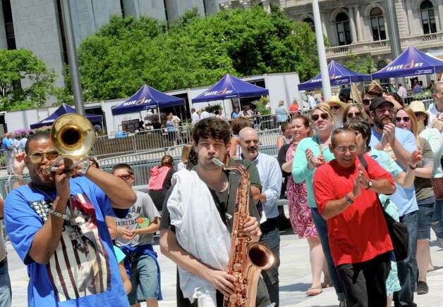 Glen David Andrews, left, and his band lead a New Orleans style second line parade through the Empire State Plaza during a Made in the Shade of the Egg lunchtime show on Wednesday, June 10, 2015, in Albany , N.Y.  (Michael P. Farrell/Times Union) Photo: Michael P. Farrell