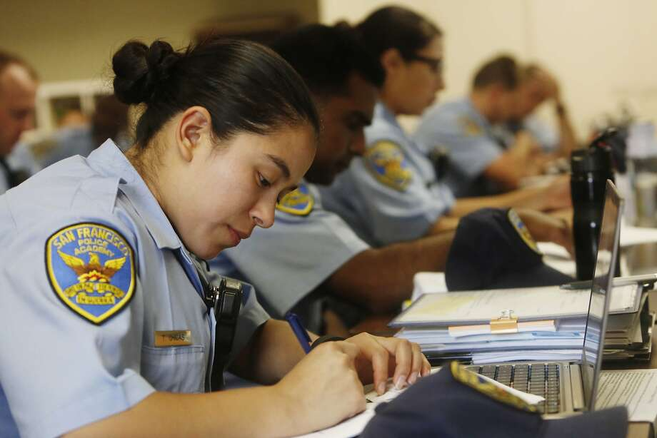 A San Francisco Police recruit takes notes as lead instructor Sergeant Tad Yamaguchi (not shown) lectures to the 246th recruit class during vehicle stop class at the San Francisco Police Academy Regional Training Center on Wednesday, June 10, 2015 in San Francisco, Calif. Photo: Lea Suzuki, The Chronicle