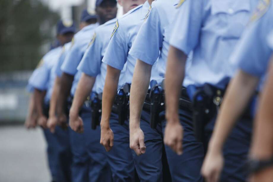 The arms of San Francisco Police recruits from the the 246th recruit class swing together as they march in formation during an exercise at the San Francisco Police Academy Regional Training Center on Wednesday, June 10, 2015 in San Francisco, Calif. Photo: Lea Suzuki, The Chronicle
