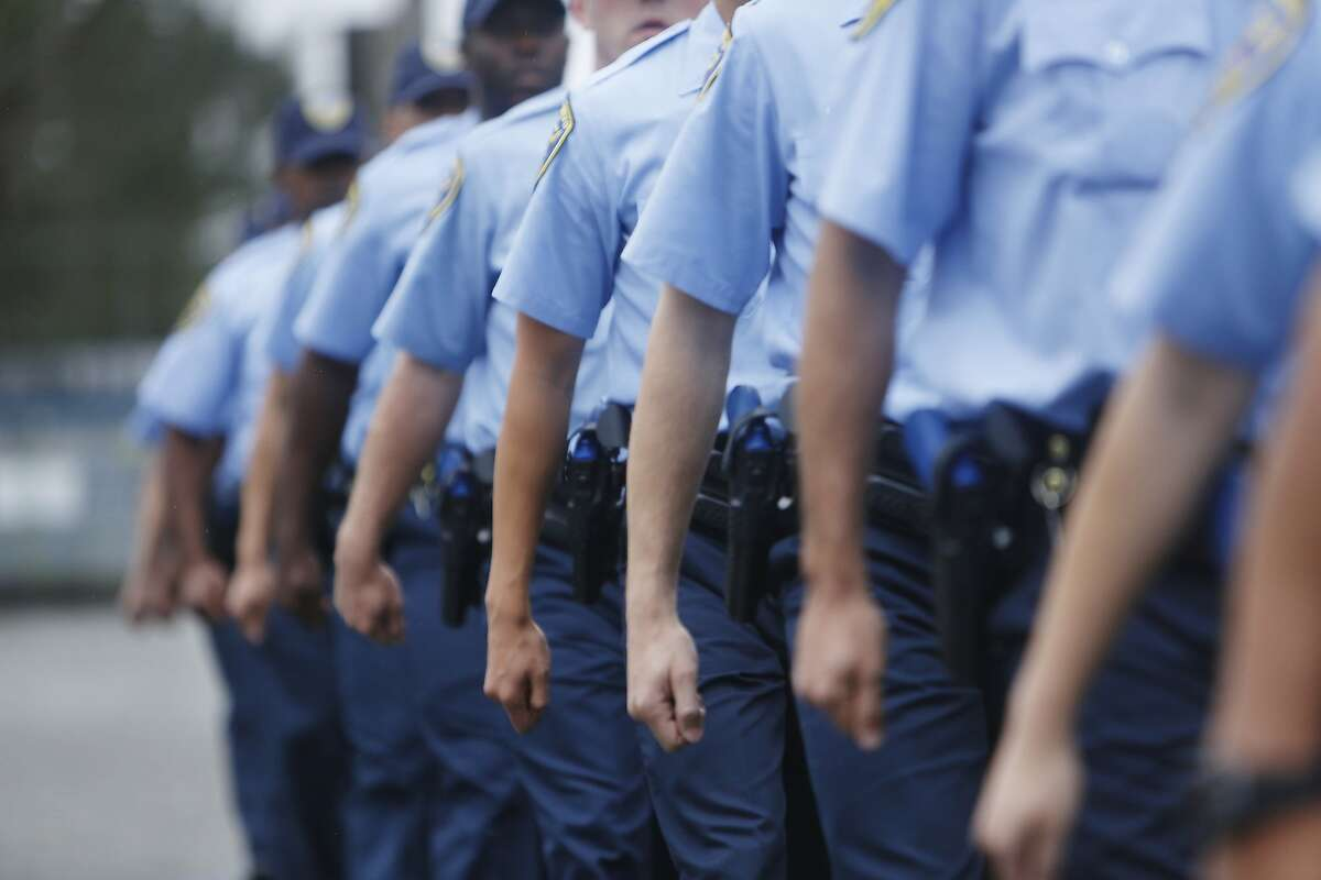 The arms of San Francisco Police recruits from the the 246th recruit class swing together as they march in formation during an exercise at the San Francisco Police Academy Regional Training Center on Wednesday, June 10, 2015 in San Francisco, Calif.