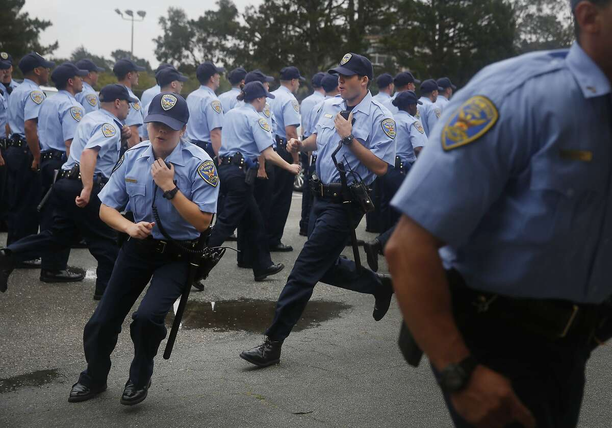 San Francisco Police recruits from the the 246th recruit class fall into the classroom after marching in formation during an exercise at the San Francisco Police Academy Regional Training Center on Wednesday, June 10, 2015 in San Francisco, Calif.