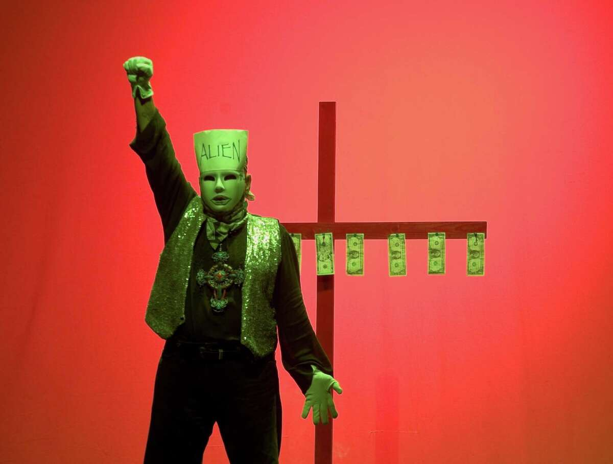 """Performance artist Jose Torres-Tama plays several characters in his solo show """"Aliens, Immigrants and Other Evildoers."""""""