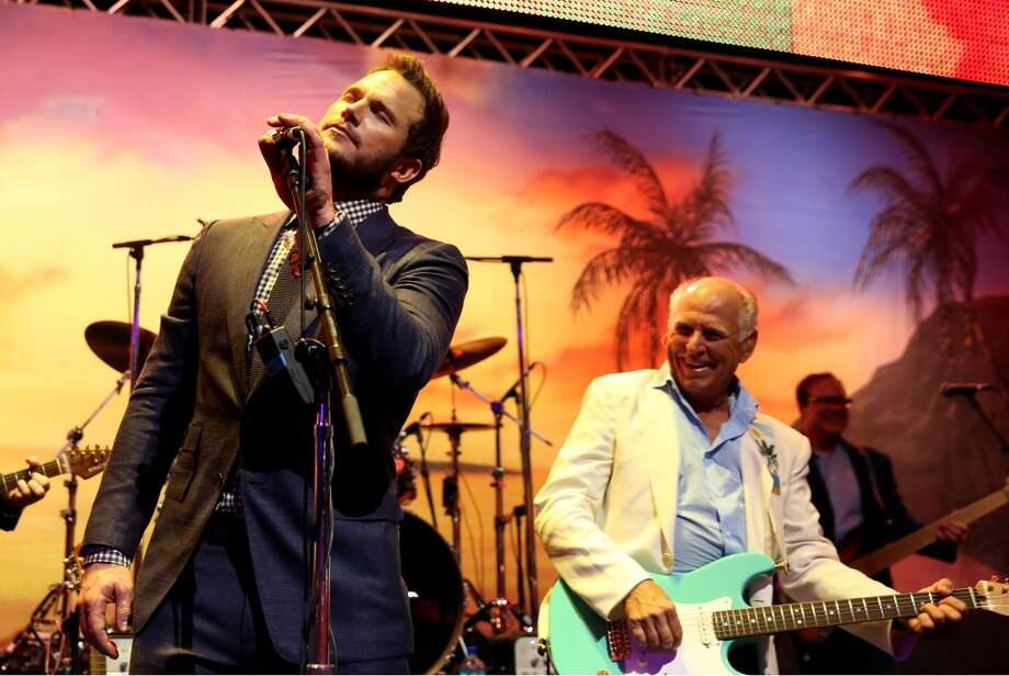 "Chris Pratt, left, and Jimmy Buffett perform at the after party for the premiere of ""Jurassic World"" in Los Angeles, Tuesday, June 9, 2015. (Photo by Matt Sayles/Invision/AP) Photo: Matt Sayles, Associated Press"