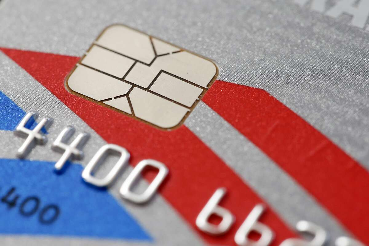 This Wednesday, June 10, 2015 photo shows a chip-based credit card, in Philadelphia. U.S. banks, tired of spending billions a year to pay back fleeced consumers, are in the process of replacing tens of millions of old magnetic strip credit and debit cards with new cards that are equipped with computer chips that store account data more securely. (AP Photo/Matt Rourke)