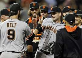 In this photo taken Tuesday, June 9, 2015, San Francisco Giants starting pitcher Chris Heston, center, celebrates with teammates after he threw a no-hitter against the New York Mets in a baseball game in New York. The Giants won 5-0. (AP Photo/Frank Franklin II)