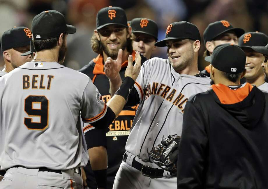 In this photo taken Tuesday, June 9, 2015, San Francisco Giants starting pitcher Chris Heston, center, celebrates with teammates after he threw a no-hitter against the New York Mets in a baseball game in New York. The Giants won 5-0. (AP Photo/Frank Franklin II) Photo: Frank Franklin II, Associated Press