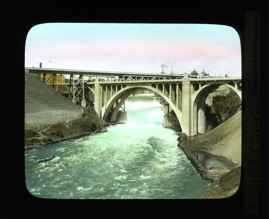 Spokane Falls, pictured between 1920 and 1930, where Avista -- then the Washington Water Power Co. -- began generating electricity in the Inland Empire. Photo: Asahel Curtis / Courtesy Of The Washington State Archives