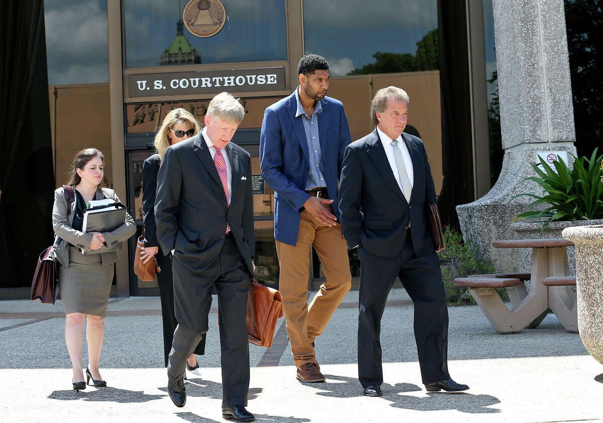 Tim Duncan exits proceedings with his legal team after he makes an appearance in federal court before U.S. District Judge Xavier Rodriguez regarding his lawsuit against Charles Banks on June 10, 2015. From left are attorney Jacqueline Garza-Rothrock, financial consultant Wendy Kowalik, attorney J. Tullos Wells, Duncan and attorney Michael D. Bernard.