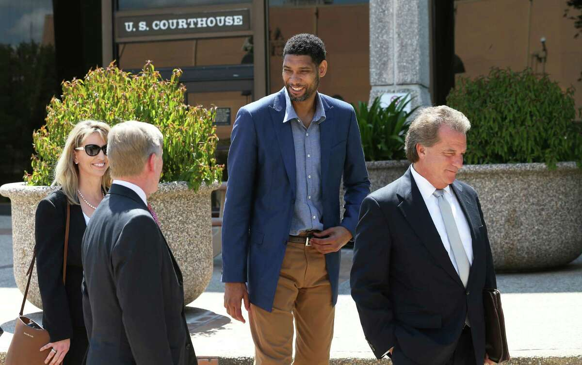 Tim Duncan enjoys a lighter moment with his legal team after he makes an appearance in federal court before U.S. District Judge Xavier Rodriguez regarding his lawsuit against Charles Banks on June 10, 2015. From left are financial consultant Wendy Kowalik, attorney J. Tullos Wells, Duncan and attorney Michael D. Bernard.
