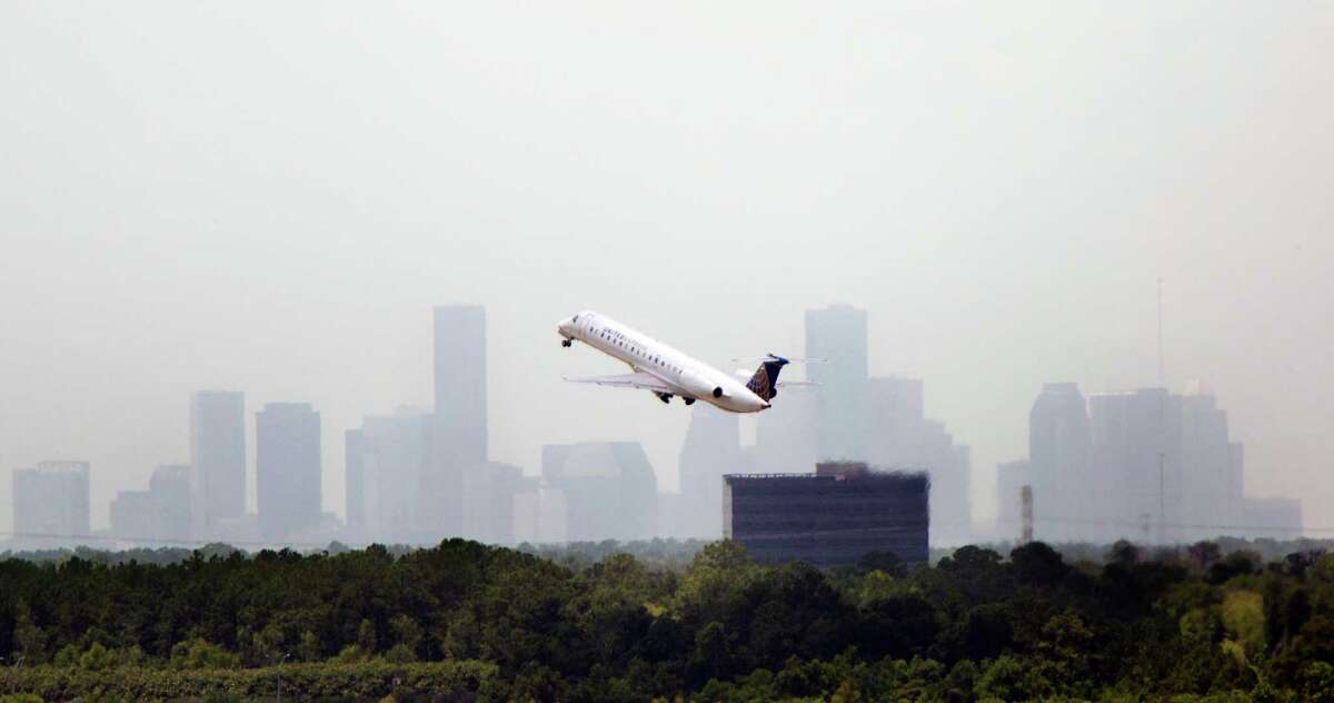 A plane takes off from George Bush Airport, Monday, July 7, 2014, in Houston. (Cody Duty / Houston Chronicle)