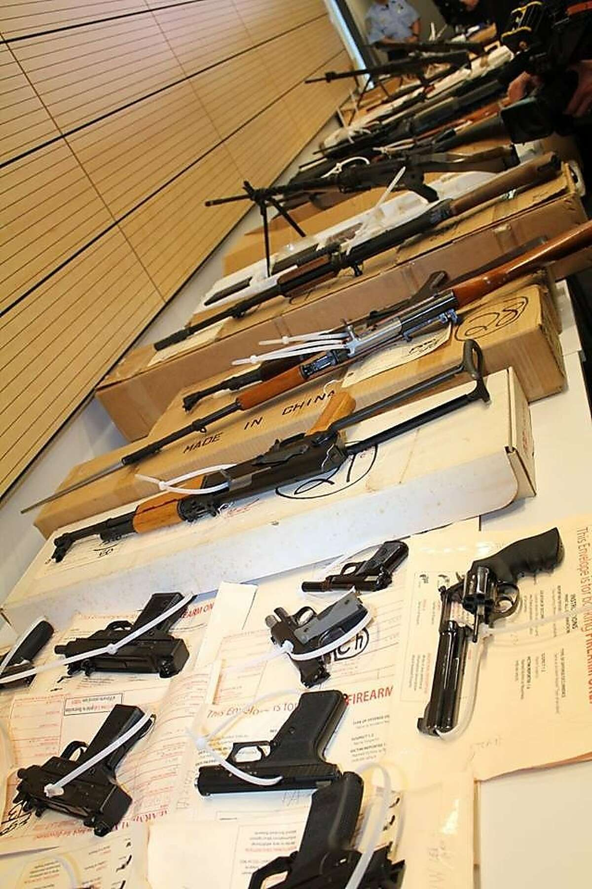 San Francisco police showed off guns seized from a robbery suspect at a news conference on June 10, 2015.