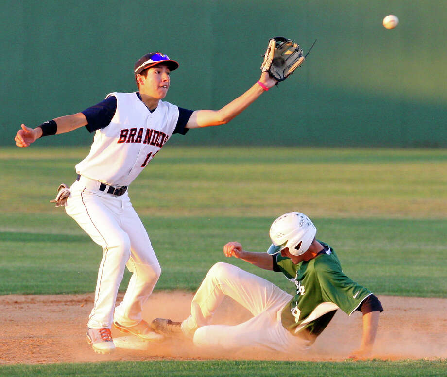 Reagan's Nick Dovalis slides safely into second base as Brandeis' Geno Encina waits for the throw during the fourth inning on May 13, 2011 at Northside Field. Brandeis won 4-1. Photo: Edward A. Ornelas / San Antonio Express-News / SAN ANTONIO EXPRESS-NEWS (NFS)