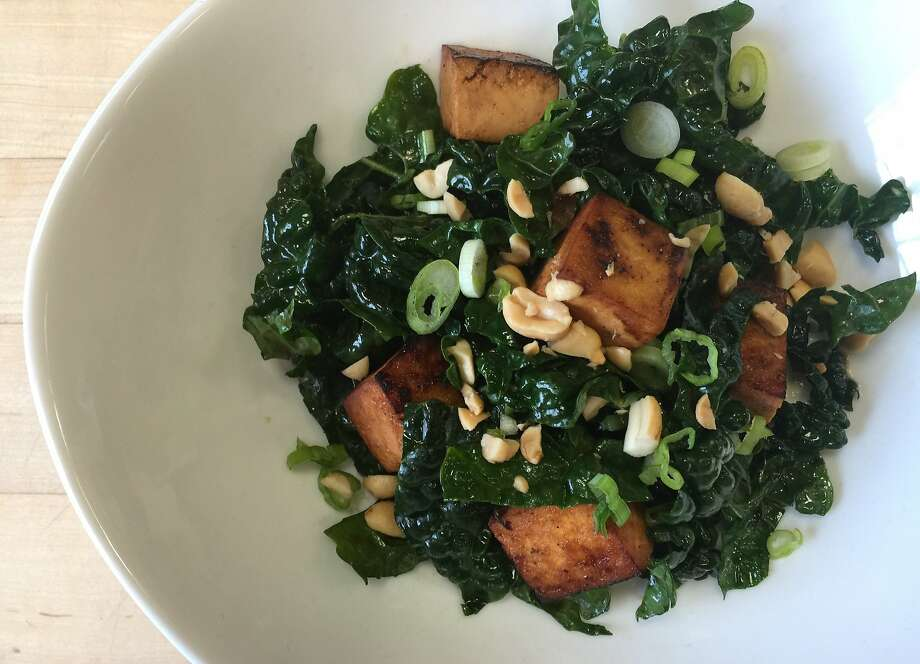 Warm tofu and kale salad with peanuts and green onions. Photo: Amanda Gold