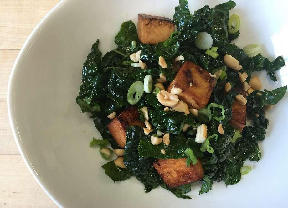 Warm tofu and kale salad with peanuts and green onions. Photo: Amanda Gold