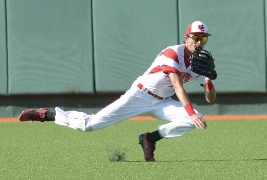 El Campo senior centerfielder Clayton Harp makes a diving catch on a ball in the top of the 6th inning against West Orange Stark during their 2015 UIL Class 4A State Baseball Championships semifinal matchup at UFCU Disch-Falk Field in Austin on Wednesday, June 10, 2015. (Photo by Jerry Baker/Freelance) Photo: Jerry Baker, For The Houston Chronicle