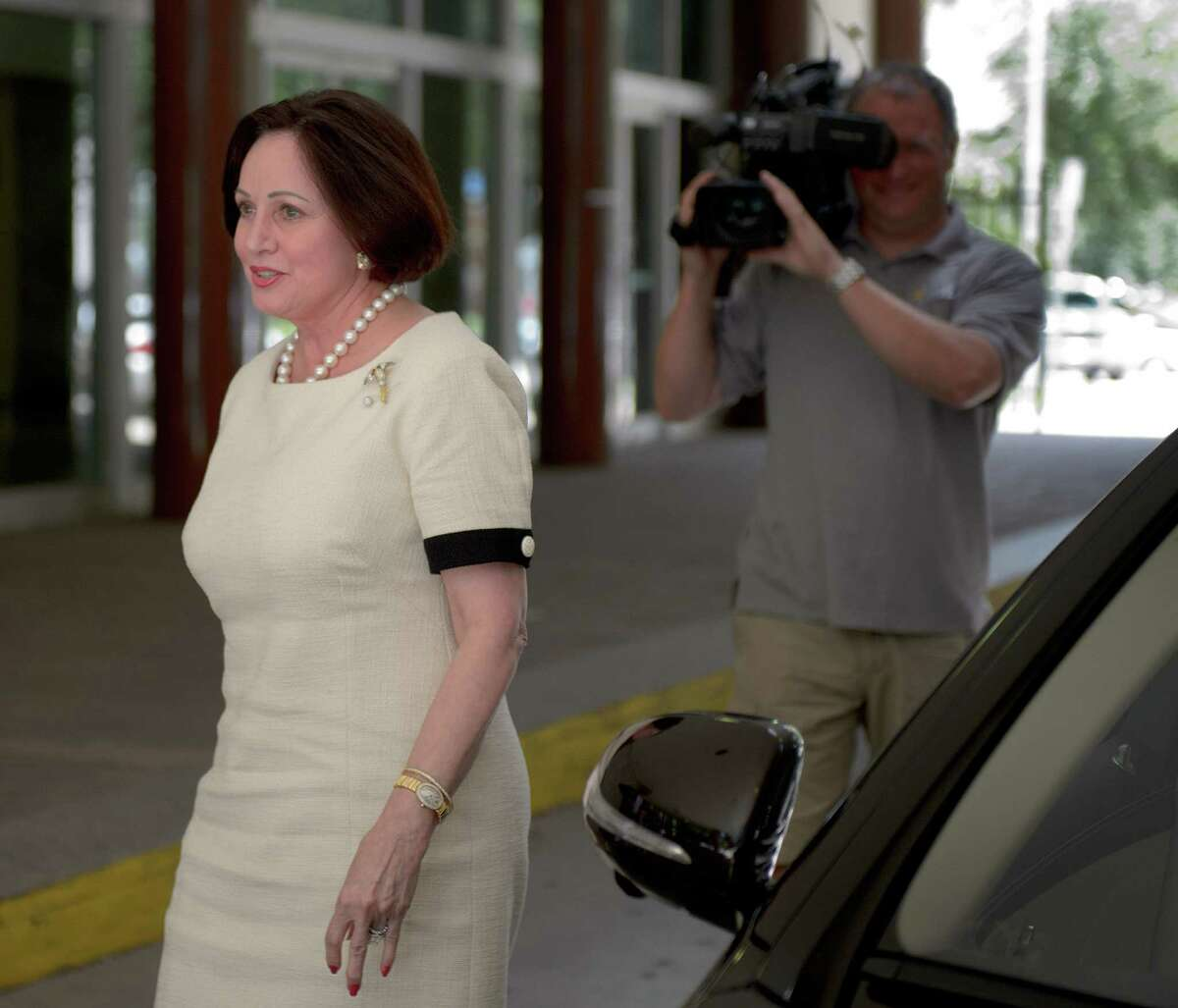Gayle Benson was named by husband Tom Benson as his primary successor, sparking the New Orleans lawsuit and others.