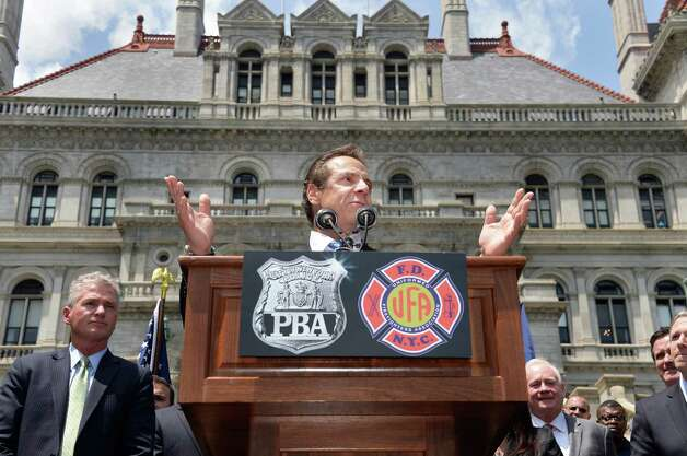 Governor Andrew Cuomo speaks to New York City firefighters and police officers as they rally to demand additional disability protections at the Capitol Wednesday June 10, 2015 in Albany, NY.  (John Carl D'Annibale / Times Union) Photo: John Carl D'Annibale / 10032241A