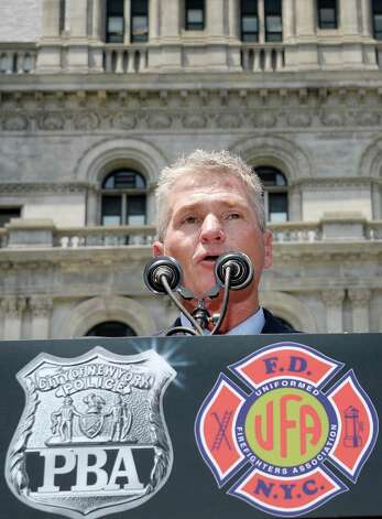 UFA President Steve Cassidy speaks to New York City firefighters and police officers as they rally to demand additional disability protections at the Capitol Wednesday June 10, 2015 in Albany, NY.  (John Carl D'Annibale / Times Union) Photo: John Carl D'Annibale / 10032241A
