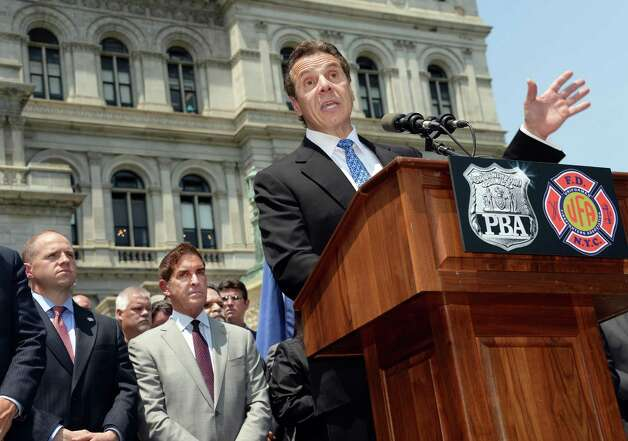 Governor Andrew Cuomo speaks to New York City firefighters and police officers as they rally to demand additional disability protections at the Capitol Wednesday, June 10, 2015, in Albany, NY.  (John Carl D'Annibale / Times Union) Photo: John Carl D'Annibale / 10032241A