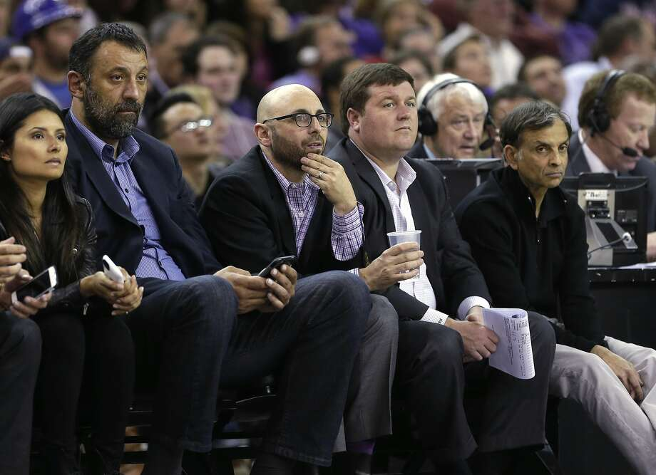 Kings general manager Pete D'Allessandro (holding cup) sits with former Kings second from left, sits with retired Kings center Vlade Divac, left, and Kings majority owner Vivek Ranadive, right, during an NBA basketball game against the Minnesota Timberwolves in Sacramento, Calif. D'Alessandro has accepted a front-office position with the Denver Nuggets, according to a league source. D'Alessandro was stripped of his decision-making power this spring when Ranadive hired Divac as the team's new vice president of basketball and franchise operations. The person second from right is unidentified. (AP Photo/Rich Pedroncelli) Photo: Rich Pedroncelli, Associated Press