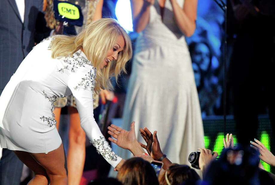 """Carrie Underwood acknowledges the audience before accepting the award for female video of the year for """"Something in the Water""""at the CMT Music Awards at Bridgestone Arena on Wednesday, June 10, 2015, in Nashville, Tenn. (Photo by Wade Payne/Invision/AP) Photo: Wade Payne, Wade Payne/Invision/AP / Invision"""
