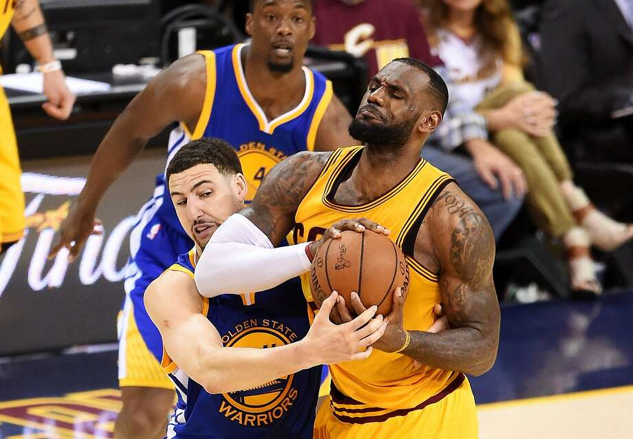 The Cavs' LeBron James has been tough to stop in a physical halfcourt game, as Klay Thompson finds in the fourth quarter of Game 3. Photo: Jason Miller, Getty Images
