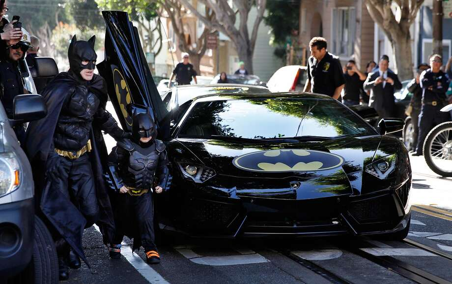 "E.L. Johnson as Batman and Miles Scott as Batkid in the documentary ""Batkid Begins."" Photo: Warner Bros."