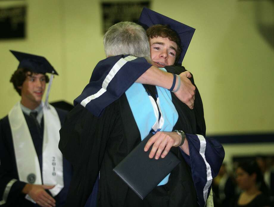 Graduate Jack Hennessy hugs Principal John Dodig after receiving his diploma at the Staples High School graduation, Wednesday afternoon, June 23, 2010 in Westport. Photo: Brian A. Pounds, ST