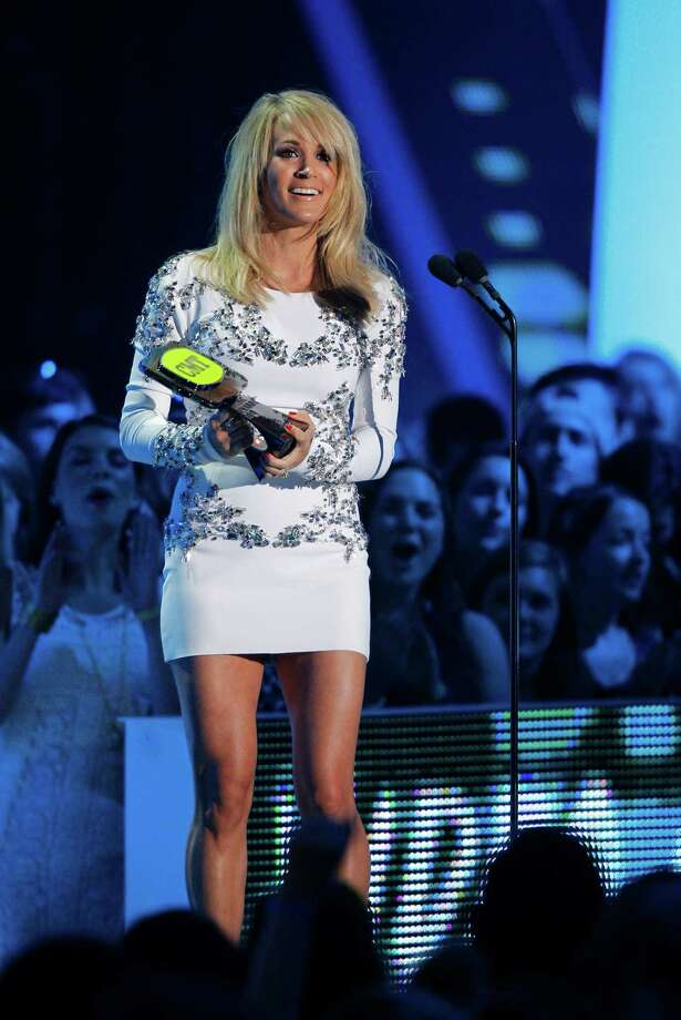 "Carrie Underwood accepts the award for collaborative video of the year for ""Somethin' Bad"" at the CMT Music Awards at Bridgestone Arena on Wednesday, June 10, 2015, in Nashville, Tenn. (Photo by Wade Payne/Invision/AP) ORG XMIT: TNDC141 Photo: Wade Payne / Invision"