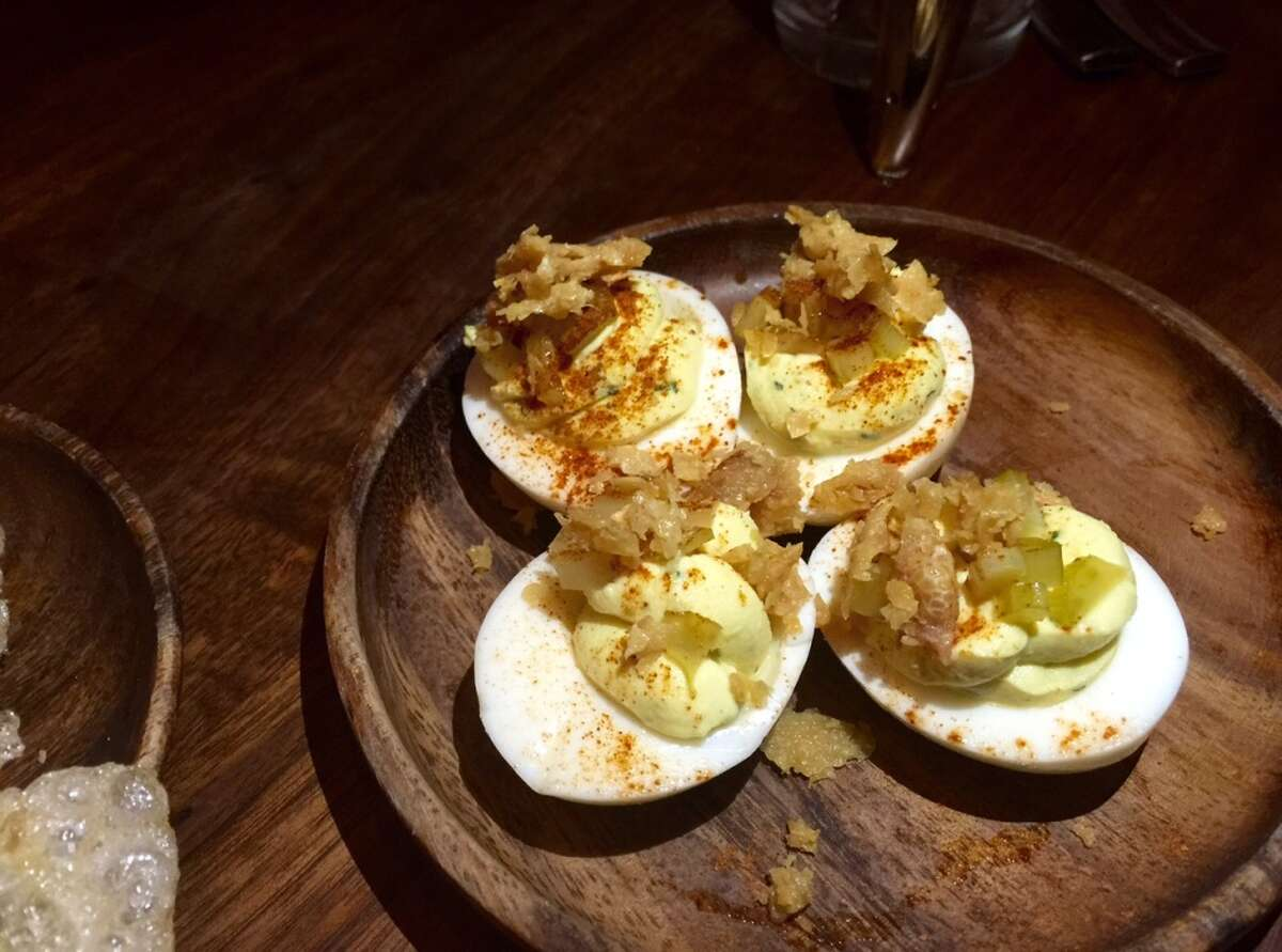 Deviled eggs with pickled celery, chicken skin and powdered Crystal Hot Sauce ($6).