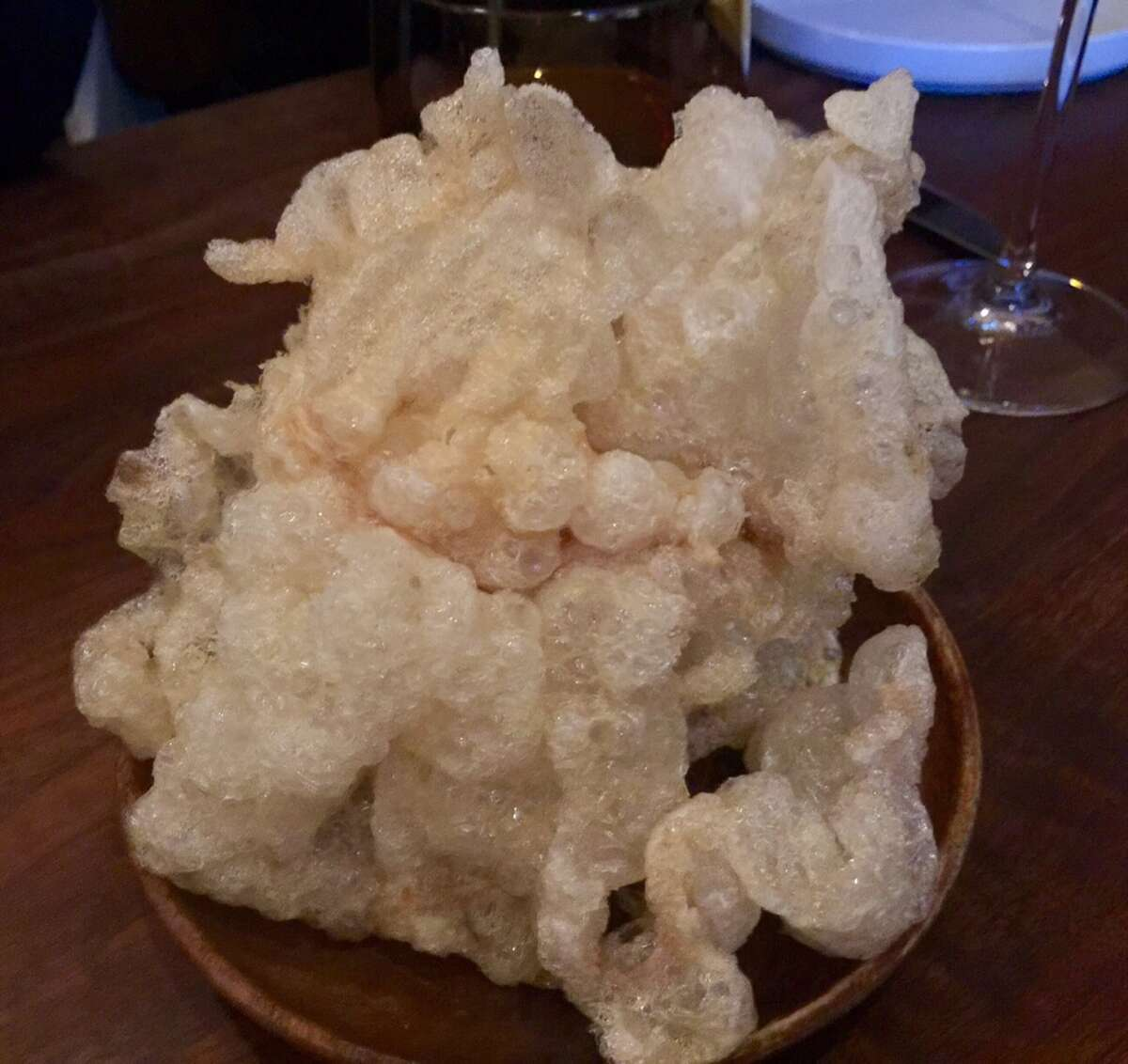 Beef tendon puffs are crisp but melt like lardo when they hit the tongue ($7).