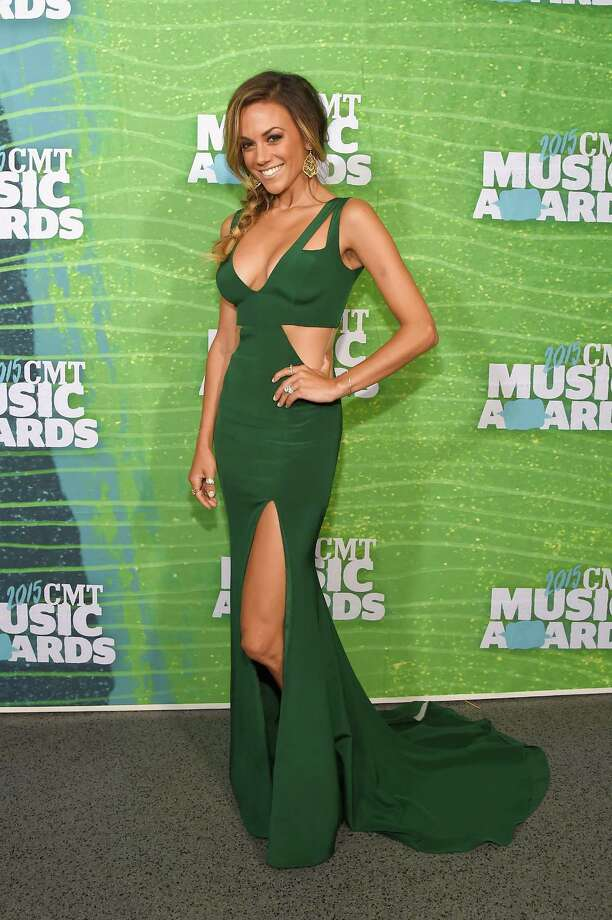 Jana Kramer's green gown is cut out in all the right places for a wow look. See who else rocked the red carpet at the CMT Music Awards. Photo: Rick Diamond, Getty Images / 2015 Getty Images