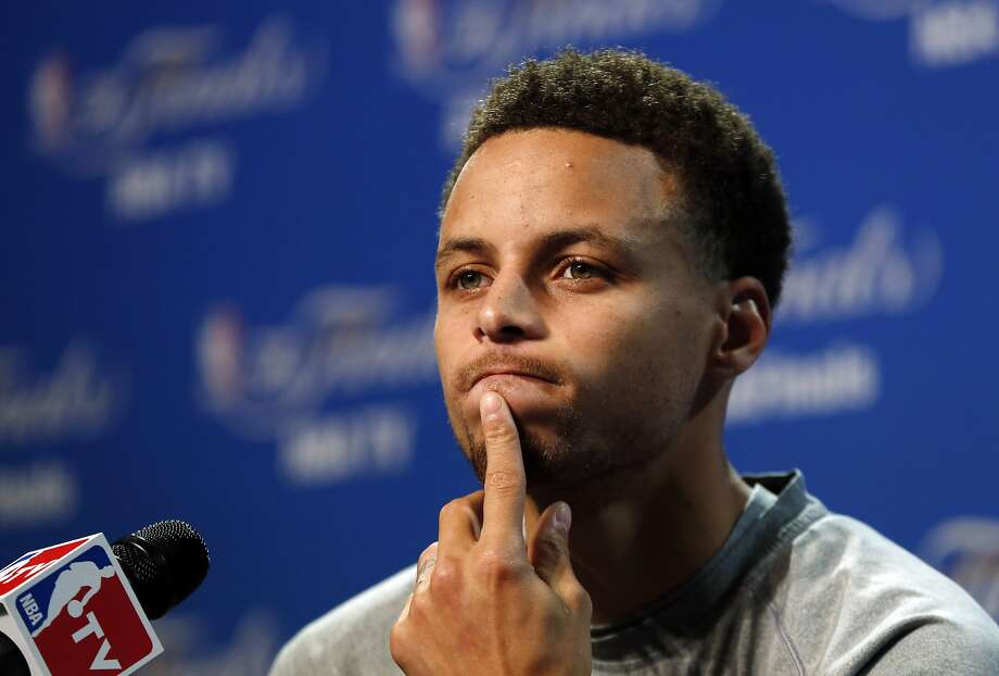 Golden State Warriors guard Stephen Curry answers a question during press conference for basketball's NBA Finals in Cleveland, Wednesday, June 10, 2015. The Cleveland Cavaliers lead the Warriors 2-1 in the best-of-seven games series.  Game 4 is scheduled for Thursday. (AP Photo/Paul Sancya) Photo: Paul Sancya, Associated Press