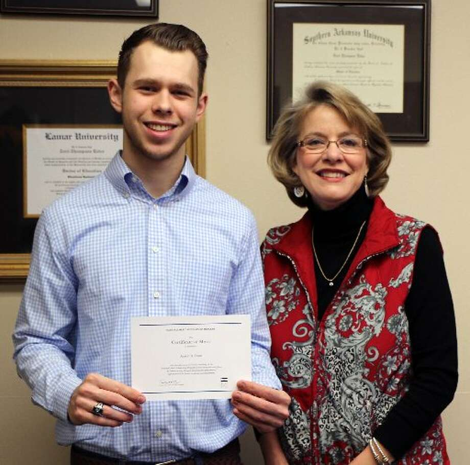 Aaron Rose, left, was named a finalist in the 2015 National Merit Scholarship Program this past March. 