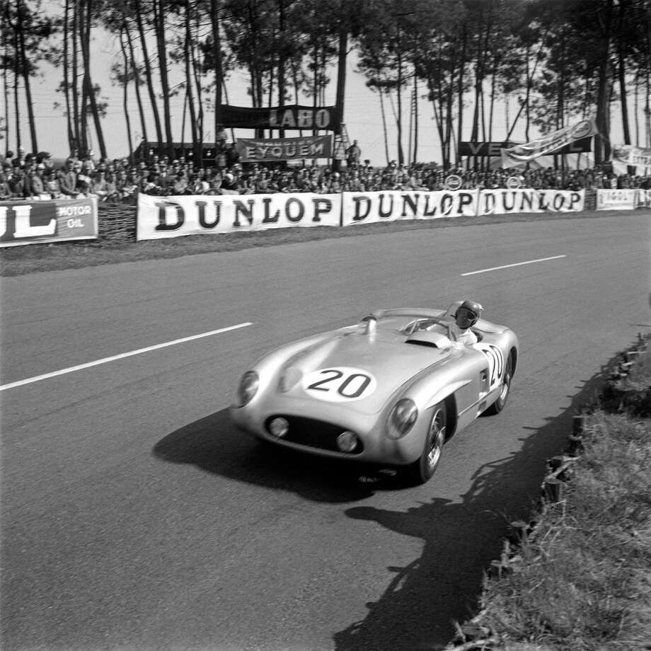 French driver Pierre Levegh steers his Mercedes Benz 300 SLR on Le Mans racetrack, during the 23th edition of the 24 hours of Le Mans race, on June 11, 1955. The 23th edition of the endurance race was marked by the terrible crash that killed 82 persons, in which French pilot Pierre Levegh, and injured 77 others. In terms of human toll, it is the most catastrophic accident in motorsports history. Photo: STRINGER, Getty Images / AFP